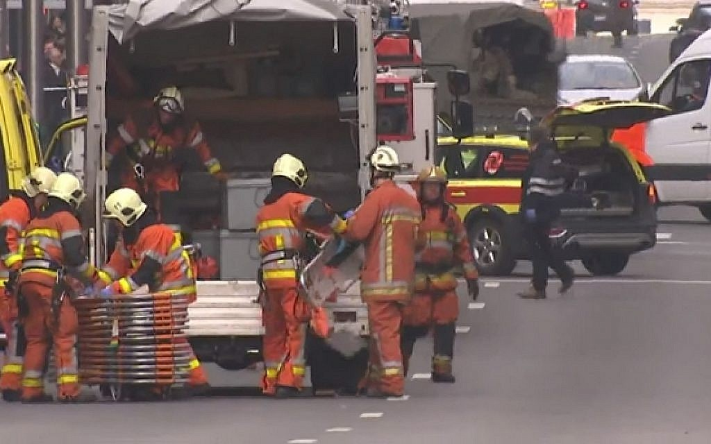 Rescue personnel attend the scene of blast at a metro station in Maalbeek, Brussels on March 22, 2016 (screen capture: YouTube)