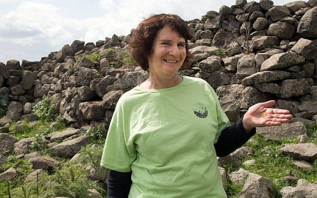 Laurie Rimon with a 2,000 year old coin she found while out hiking. (Samuel Magal, courtesy of the Israel Antiquities Authority)
