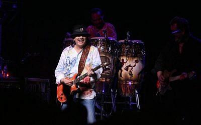 Carlos Santana performs (