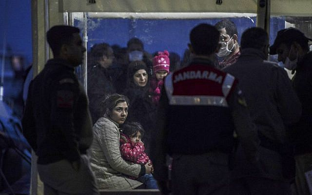 Syrian refugees are detained by the Turkish coastguard after they tried to reach the Greek island of Lesbos on March 3, 2016, Kucukkuyu, Canakkale. (AFP/BULENT KILIC)