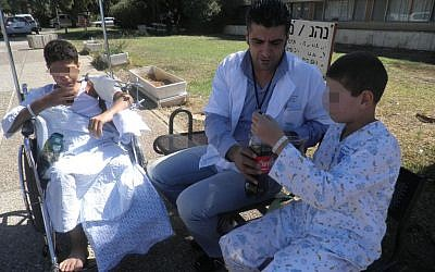 Illustrative: Syrian children being treated at the Ziv Medical Center in Safed (Courtesy)
