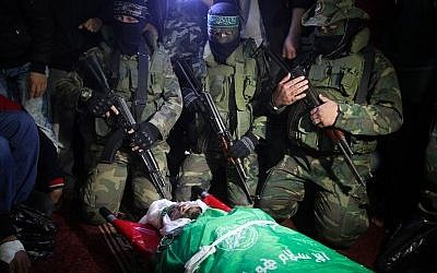 Palestinian members of the Ezzedine al-Qassam Brigades, seen near the body of Marwan Maarouf, 27, during his funeral in Khan Yunis in the southern Gaza Strip, on February 9, 2016. Maarouf was killed when a tunnel collapsed in the Gaza Strip. Photo by Abed Rahim Khatib/Flash90.