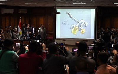 """Egypt's Antiquities Minister Mamduh Damati (3L) speaks during a press conference at the antiquities ministry in Cairo about radar scans of the tomb of pharaoh Tutankhamun in the ancient necropolis of Luxor which show a """"90 percent"""" chance of two hidden chambers, possibly containing organic material, March 17, 2016.  / AFP / MOHAMED EL-SHAHED"""