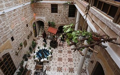 Palestinian university professor Atef Salama stands in his house, a 430-year-old Levantine-style palace, on February 6, 2016, in Gaza City. (AFP PHOTO / MAHMUD HAMS)