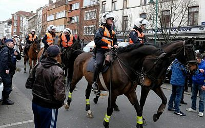 Local youth and police on horseback gather in the street of Molenbeek-Saint-Jean in Brussels, on April 2, 2016. (Nicolas Maeterlinck/Belga/AFP)