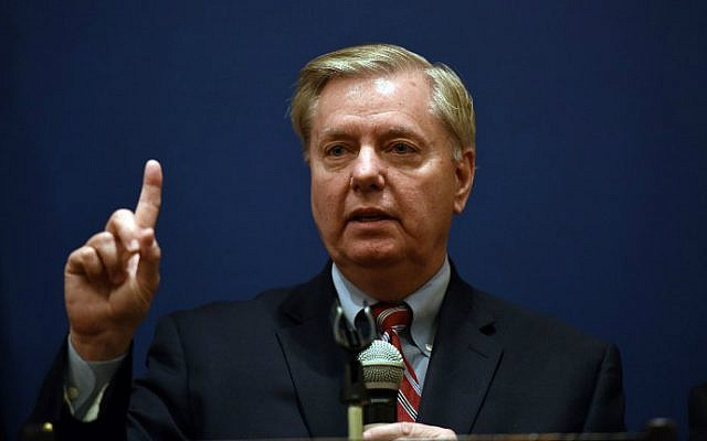 Senator Lindsey Graham gestures during a press conference with members of his Congressional delegation in Caira, Egypt, on April 3, 2016. (AFP/Mohamed el-Shahed)
