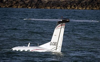 A light plane after it made an emergency landing in the Mediterranean off the coast of Tel Aviv, on April 3, 2016. (AFP / JACK GUEZ)