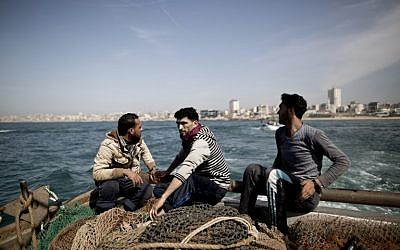 Gaza fishermen as they start fishing off the coast of the Gaza Strip on April 3, 2016. (AFP/Mahmud Hams)
