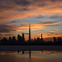 A photo of Dubai's skyline with Burj Khalifa, the world's tallest tower in the center, as the sun sets over Dubai, United Arab Emirates, on April 4, 2016. (AFP/Karim Sahib)