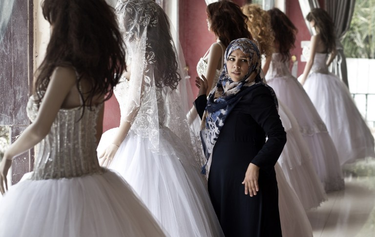 A Palestinian Girl Looks At Wedding Dresses Shop In Gaza City On April 5