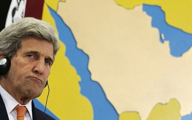 US Secretary of State John Kerry sits in front of a map of Saudi Arabia and the Persian Gulf during a joint press conference with Saudi Arabia's foreign minister in the Bahraini capital of Manama, on April 7, 2016. (AFP/Jonathan Ernst/Pool)