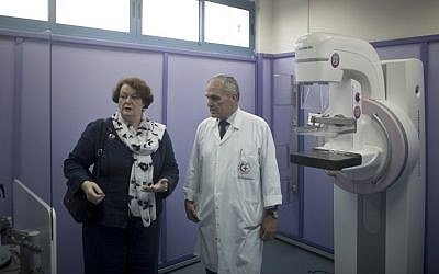 Philippa Whitford (L), an MP for Central Ayrshire in Scotland and a breast cancer expert, visits al-Ahli Hospital with its medical director Doctor Maher Ayyad in Gaza City on April 5, 2016. (AFP Photo/Mahmud Hams)
