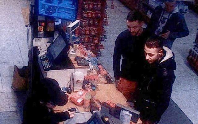 This file video image taken from a CCTV camera at a petrol station in Ressons, North of Paris, on November 11, 2015 shows Salah Abdeslam (R), a suspect in the Paris attack of November 13, and Mohamed Abrini (C) buying goods. Abrini was arrested on April 8, 2016, according to police sources. (AFP PHOTO / OFF)