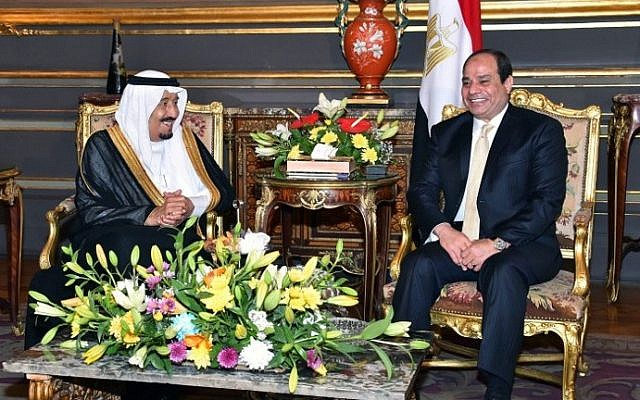 A handout picture released by the Egyptian Presidency on April 9, 2016 shows Egyptian President Abdel Fattah al-Sisi (R) meeting with Saudi King Salman bin Abdulaziz as part of a signing ceremony for bilateral agreements at the Abdeen Palace in the capital Cairo.   (AFP PHOTO / EGYPTIAN PRESIDENCY)
