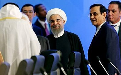 President of Iran Hassan Rouhani (C) attends the 13th Organization of Islamic Cooperation (OIC) Summit at Istanbul Congress Center (ICC) on April 14, 2016 in Istanbul. (AFP/SEBNEM COSKUN)