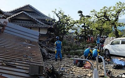Policemen prepare for a rescue mission in Mashiki, Kumamoto prefecture, on April 16, 2016, after a powerful earthquake hit southern Japan. (AFP/Kazuhiro Nogi)
