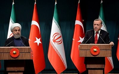 Turkish President Recep Tayyip Erdogan (R) speaks during a joint press conference with Iranian counterpart Hassan Rouhani (L) following their meeting, at the presidential complex, in Ankara, on April 16, 2016. (AFP PHOTO / ADEM ALTAN)