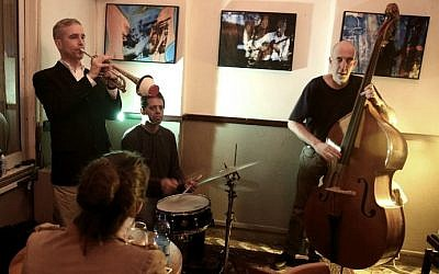 "The ""Olden You Quartet"" plays at the Beit Haamudim bar and jazz club during a concert in Tel Aviv on April 5, 2016. (AFP PHOTO / MENAHEM KAHANA)"