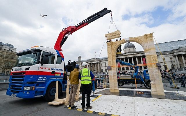 A replica of Palmyra's Arch of Triumph is erected in Trafalgar Square, central London, on 18 April 2016. The original arch was destroyed by the Islamic State group (IS) and the replica has been crafted using the latest 3D printing and carving technologies by the Institute for Digital Archaeology. (AFP PHOTO / LEON NEAL)
