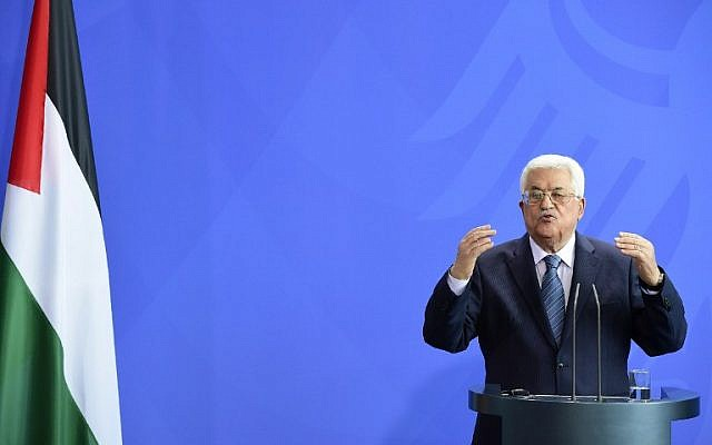 Palestinian Authority President Mahmoud Abbas speaks during a press conference after a meeting with German Chancellor Angela Merkel on April 19, 2016 at the chancellery in Berlin. (AFP PHOTO / TOBIAS SCHWARZ)