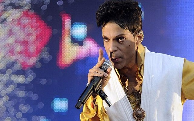 This file photo taken on June 30, 2011 shows US singer and musician Prince performing on stage at the Stade de France in Saint-Denis, outside Paris. (AFP PHOTO / BERTRAND GUAY)