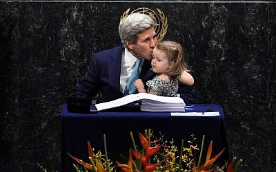 US Secretary of State John Kerry kisses his granddaughter, Isabelle Dobbs-Higginson, after signing during the signature ceremony for the Paris Agreement at the United Nations General Assembly Hall on April 22, 2016 in New York. (AFP PHOTO/JEWEL SAMAD)