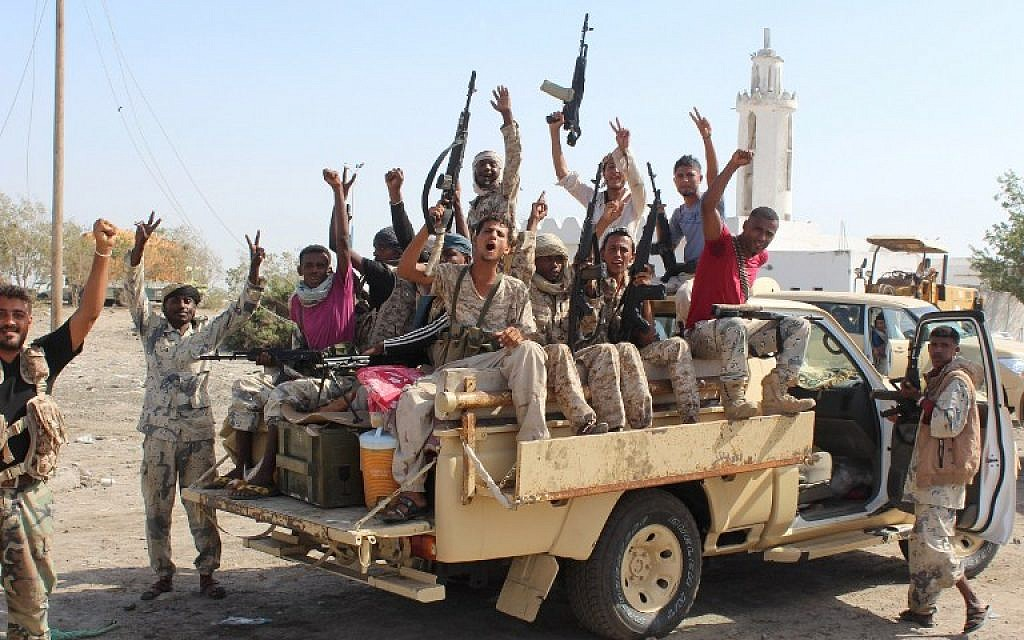 Illustrative: Forces loyal to the Saudi-backed Yemeni president flash their arms on a road at the entrance to Abyan province as they take part in an operation to drive Al-Qaeda fighters out of the southern provincial capital, on April 23, 2016. (AFP Photo/Saleh Al-Obeidi)