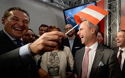 Austrian presidential candidate Norbert Hofer (right) of the right-wing Freedom Party celebrates after hearing preliminary election results in Vienna, April 24, 2016. (AFP/APA/Robert Jaeger)