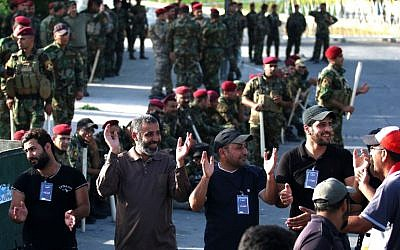 Iraqis shout slogans in front of security forces during a demonstration asking for reforms on April 26, 2016 at an entrance to the heavily fortified Green Zone in Baghdad. (AFP/Haidar Mohammed Ali)