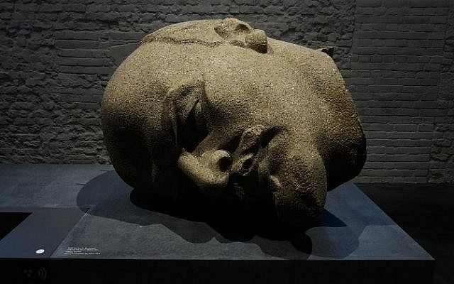"""The head of a 19-meter high statue of former Soviet leader Vladimir Lenin is on display at the permanent exhibition """"Unveiled. Berlin and its Monuments"""" in Berlin's Spandau Citadel museum. (AFP/John MacDougall)"""