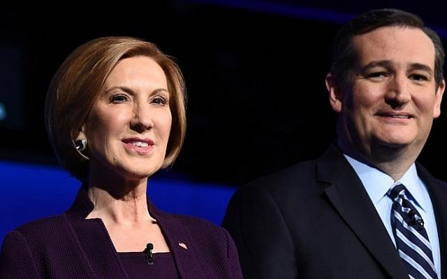 Republican presidential hopefuls Carly Fiorina (L) and Ted Cruz waiting for the start of the CNBC Republican Presidential Debate at the Coors Event Center at the University of Colorado in Boulder, Colorado on October 28, 2015. (AFP PHOTO / ROBYN BECK)