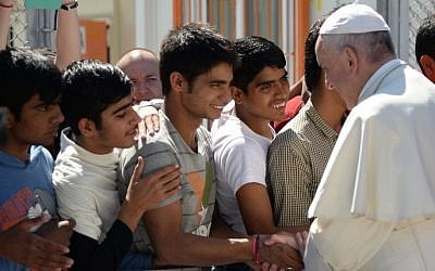 Pope Francis greets migrants and refugees at the Moria refugee camp on April 16, 2016 near the port of Mytilene, on the Greek island of Lesbos. (AFP PHOTO POOL/FILIPPO MONTEFORTE)