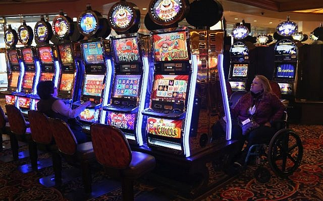 Patrons play the slots at the Trump Taj Mahal casino hotel on in Atlantic City, New Jersey, March 30, 2016. (John Moore/Getty Images/AFP)