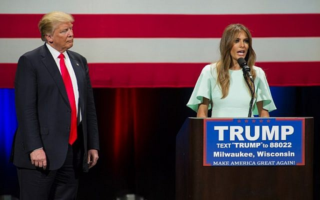 Republican presidential candidate Donald Trump listens to his wife Melania Trump speak to supporters at a campaign stop on April 4, 2016 in Milwaukee, Wisconsin. (Darren Hauck/Getty Images/AFP)
