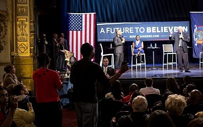 A man interrupts Democratic presidential candidate Sen. Bernie Sanders during a Community Conversation at the Apollo Theater in the Harlem neighborhood of New York City April 9, 2016.  (Eric Thayer/Getty Images/AFP)