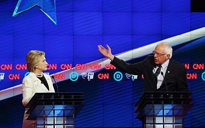 Democratic Presidential candidates Hillary Clinton, right, and Sen. Bernie Sanders debate during the CNN Democratic Presidential Primary Debate at the Duggal Greenhouse in the Brooklyn Navy Yard on April 14, 2016 in New York City. (Justin Sullivan/Getty Images/AFP)