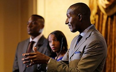 Former 'The Apprentice' participants Kwame Jackson and Tara Dowdell look on as former participant Dr. Randel Pinkett speaks at the 'Former Apprentices Speak Out: Donald Trump, You're Fired!' press conference at the Roosevelt Hotel in New York City, April 15, 2016. (Jemal Countess/Getty Images/AFP)