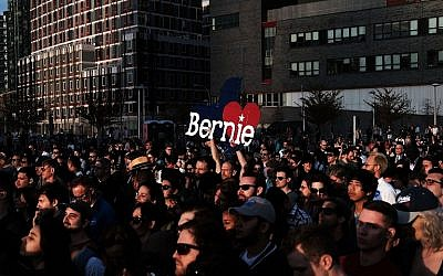 People listen as Democratic Presidential candidate Bernie Sanders speaks at a campaign rally in the Queens borough of New York City on the eve of the New York primary, April 18, 2016. (Spencer Platt/Getty Images/AFP)