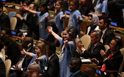 Children from around the world stand in a procession with world leaders and country delegates in the General Assembly Hall at the United Nations Signing Ceremony for the Paris Agreement climate change accord on April 22, 2016. (Spencer Platt/Getty Images/AFP)