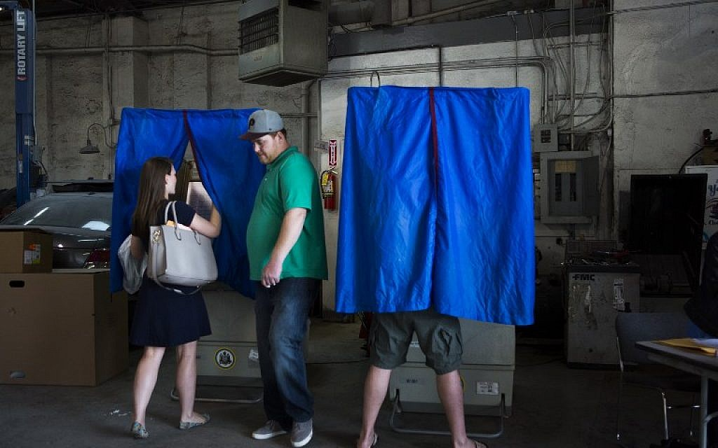 Local residents cast their primary day ballots on April 26, 2016 in Philadelphia, as primary voting takes place in Pennsylvania, Maryland, Delaware, Rhode Island, and Connecticut. (Jessica Kourkounis/Getty Images/AFP)