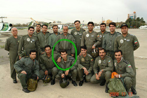 An undated photo of Major Ahmad-Reza Khosravi (circled), a former pilot in the helicopter unit of the Iranian Security Services, with colleagues. (Courtesy)