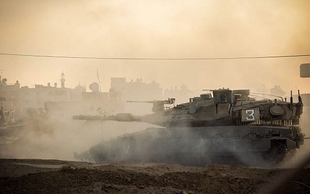An Israeli tank drives through an undisclosed area of the Gaza Strip during Operation Protective Edge on July 31, 2014. (IDF Spokesperson's Unit)