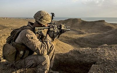 US Marine Corps Sgt. Josh Greathouse scans the area during a perimeter patrol in Al Taqaddum, Iraq, March 21, 2016. (Sgt. Rick Hurtado, Marine Corps/Defense Department)