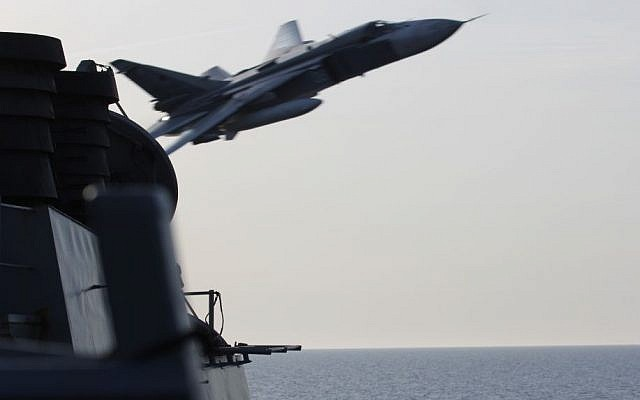 A Russian Sukhoi Su-24 attack aircraft makes a very-low-altitude pass by the USS Donald Cook in international waters in the Baltic Sea, April 12, 2016. (US Navy)
