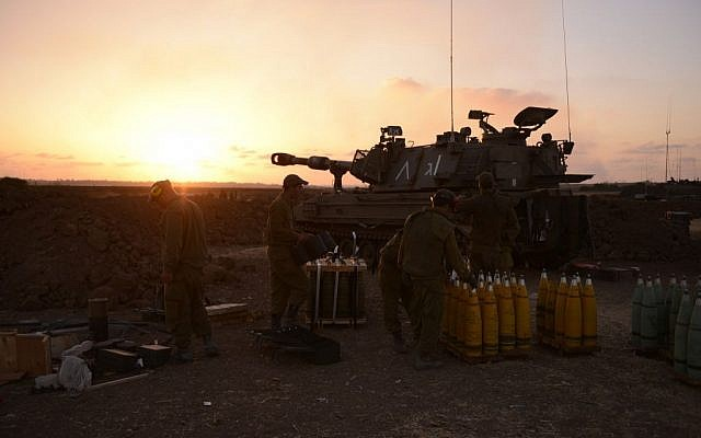 File. IDF Artillery Corps soldiers operate a howitzer on the border with Gaza, during Operation Protective Edge in summer 2014. The army fired roughly 34,000 artillery shells into Gaza during the 50-day operation (IDF Spokesperson's Unit)