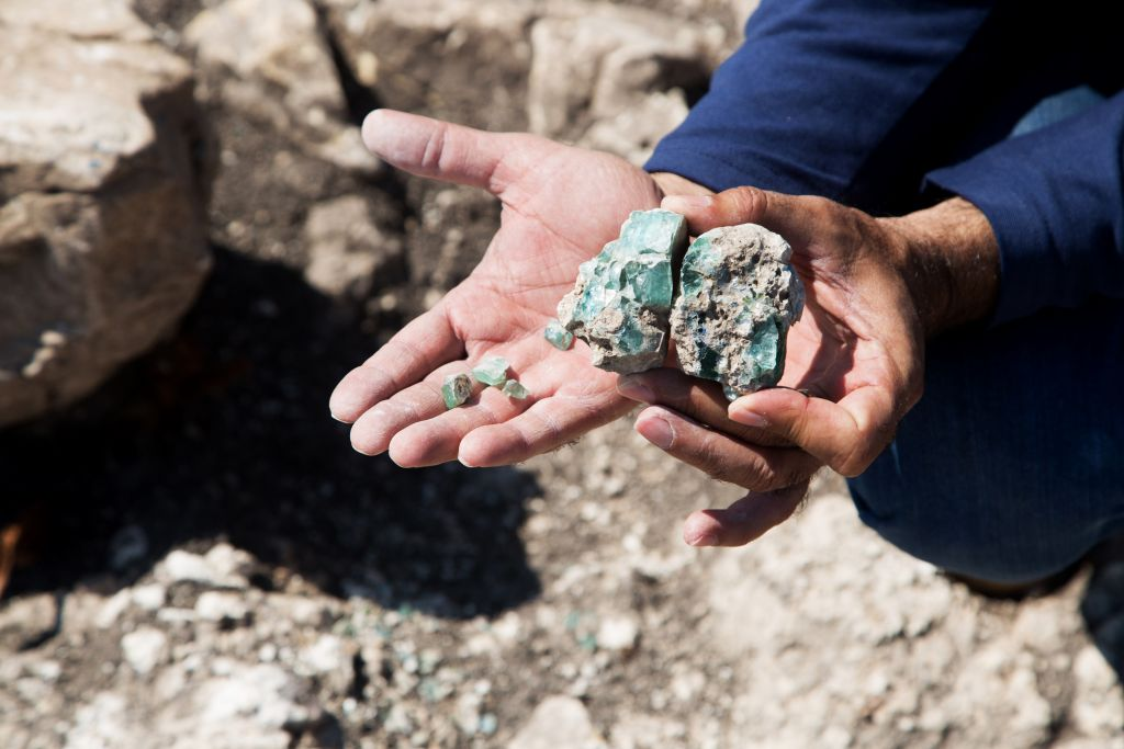 Small fragments of raw glass as they were found at a Roman-era site in northern Israel in 2015. (Shmuel Magal, courtesy of Israel Antiquities Authority)