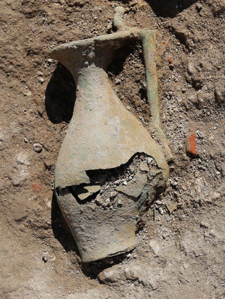A 2,200-year-old bronze jug as it was discovered in the excavation at Magdala. (Eyad Bisharat, courtesy of Israel Antiquities Authority)
