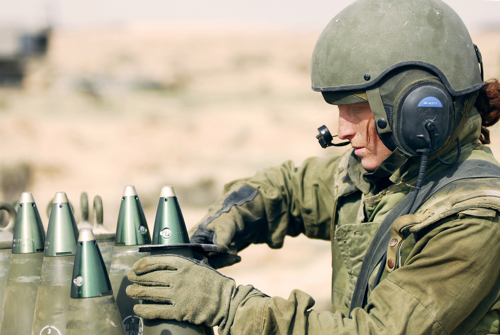 File: A female Artillery Corps soldier prepares a shell at the IDF's Shivta military base, in the Negev desert, on November 18, 2008. (IDF Spokesperson's Unit/Flickr)