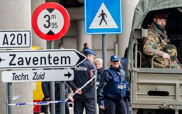 Belgian police and soldiers secure the area outside Zaventem Airport in Brussels, Tuesday, March 29, 2016. (AP Photo/Geert Vanden Wijngaert)