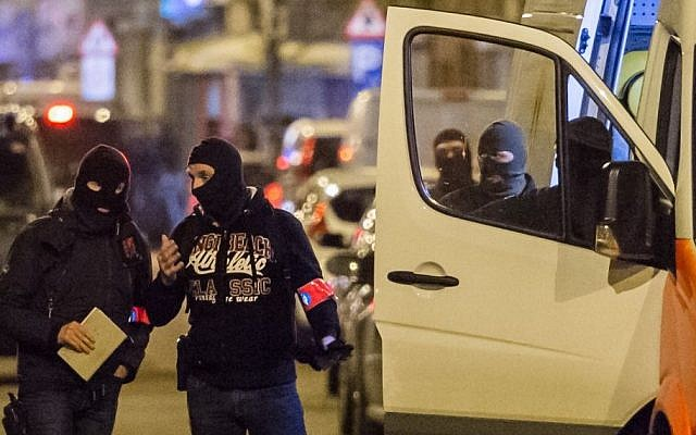 File: Police investigate an area where terror suspect Mohamed Abrini was arrested in Brussels on Friday April 8, 2016.  (AP/Geert Vanden Wijngaert)